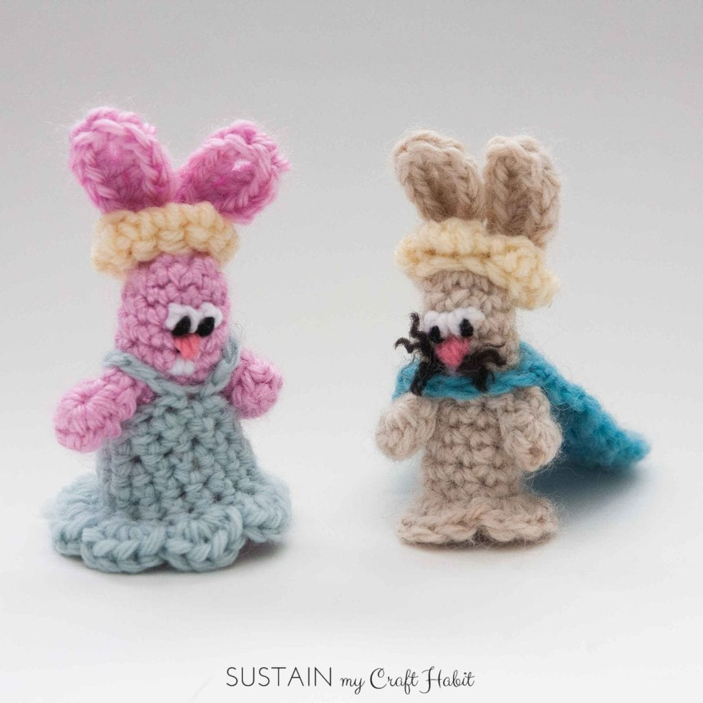 Pink and brown crochet bunny finger puppets on a white background