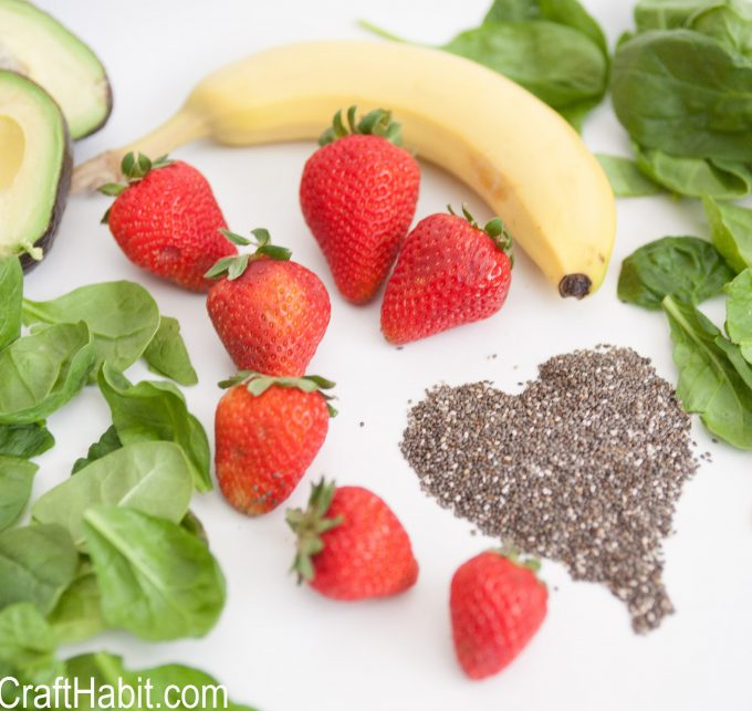 Strawberries, bananas, spinach, avacados and chia seeds to make a spinach smoothie recipe