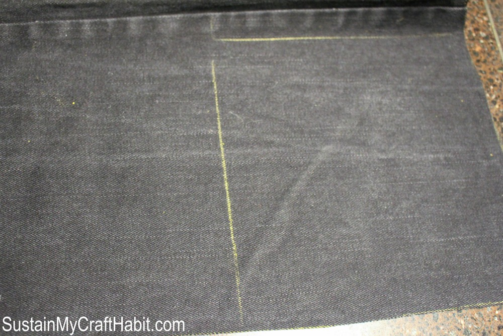 Fabric chalk lines of a section of grey denim