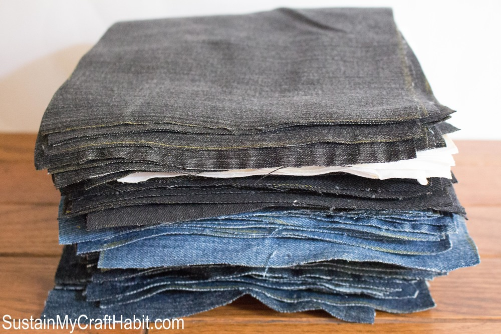 Stack of cut-out denim squares prior to sewing the picnic blanket