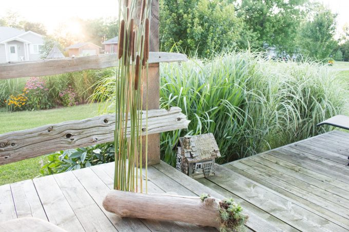 Natural porch decor idea made wiht driftwood and cattails plus over a dozen other driftwood craft ideas.