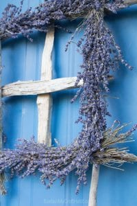 A square lavender wreath with driftwood plus over a dozen DIY ideas using beach wood.