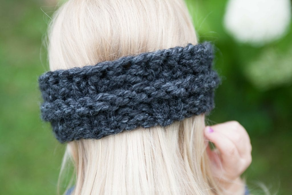 Back view of a child's knitted headband from a free knitting pattern
