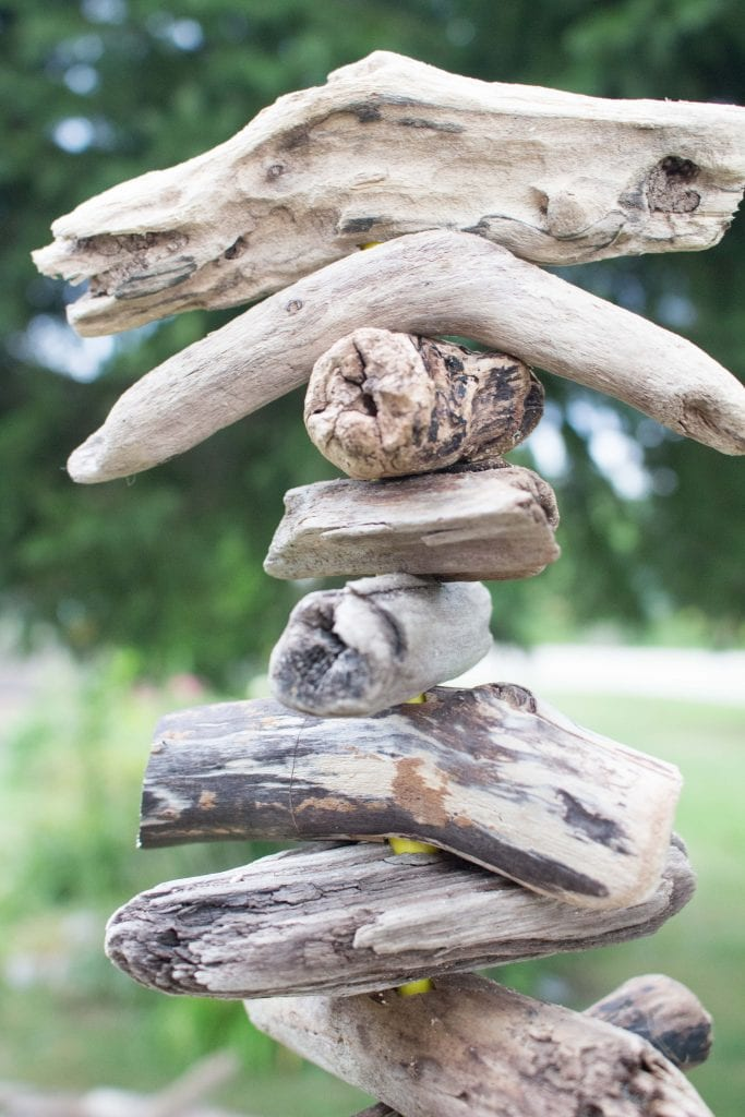 Close up image of variations in driftwood pieces at the top of a DIY driftwood Christmas tree