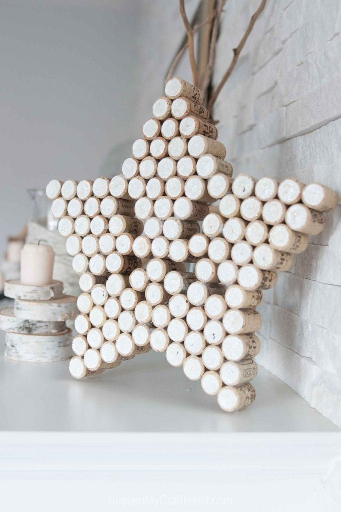 Sparkling star made with painted wine corks as a part of a Christmas mantle