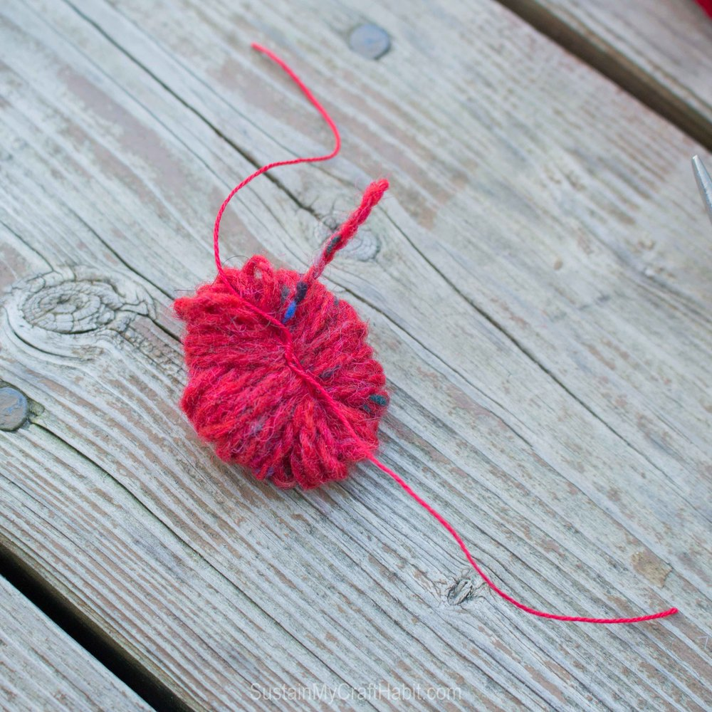 Would yarn for a DIY pom pom prior to cutting the loops with scissors