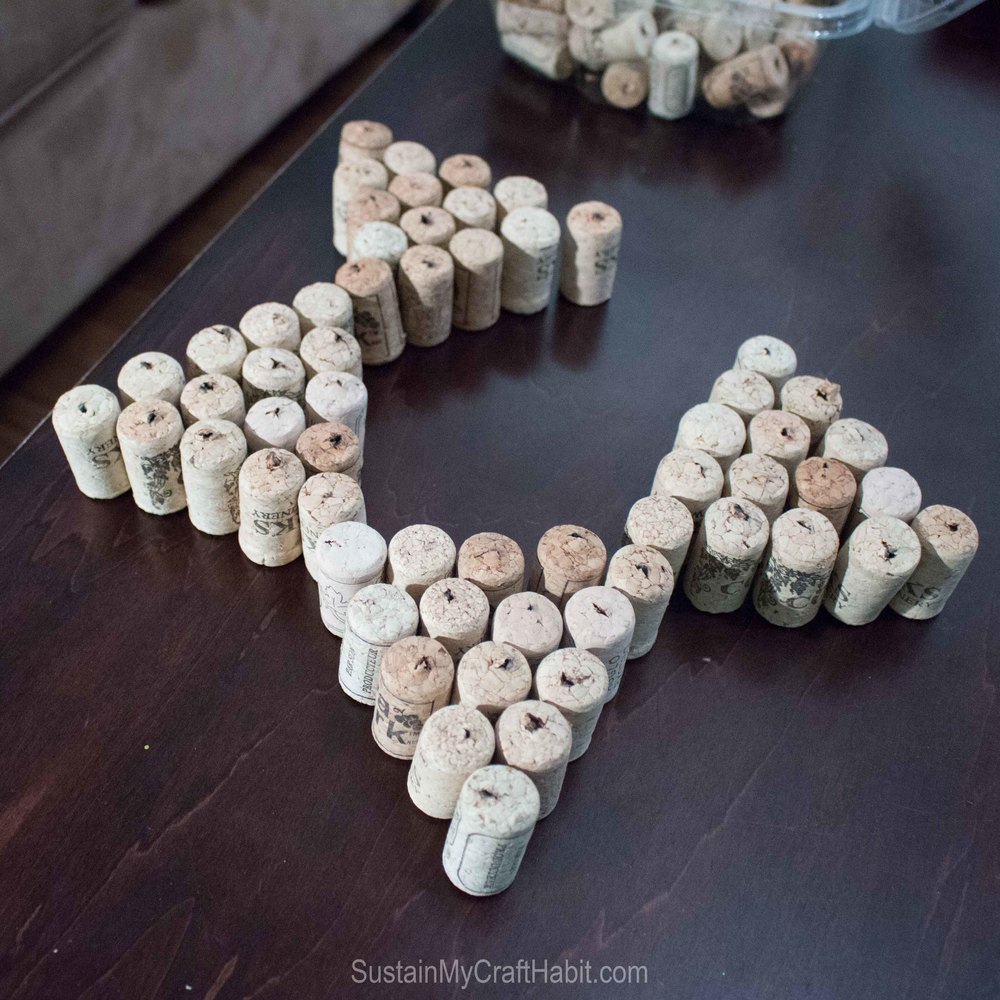 Arranging the wine cork triangles to form a star shape