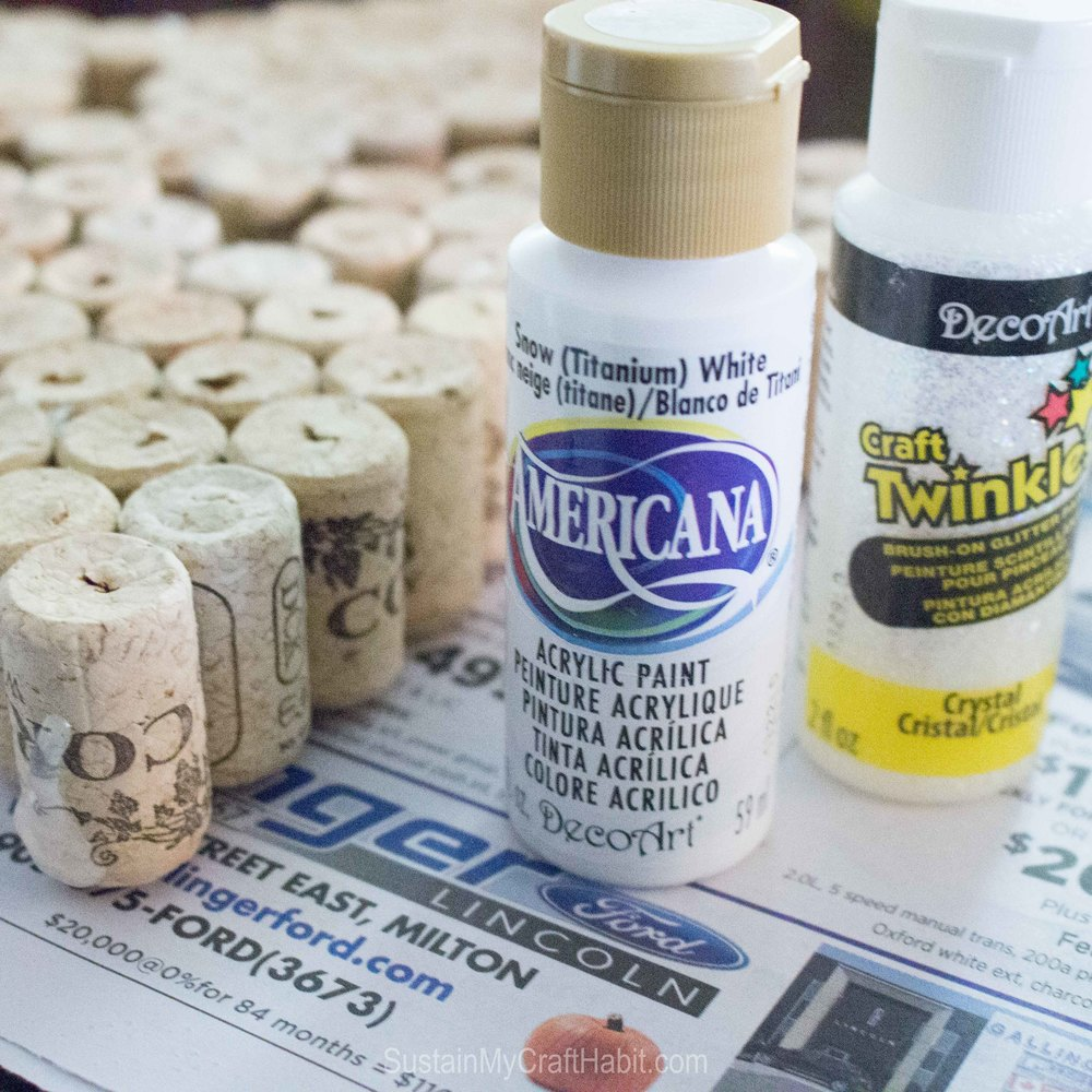 White acrylic paint used to paint the surface of the wine corks for this wine cork crafts idea