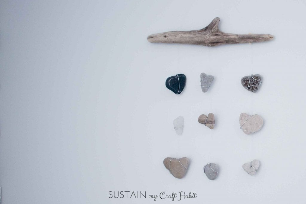 Driftwood, sea glass and beach stones wall hanging nautical decor idea.
