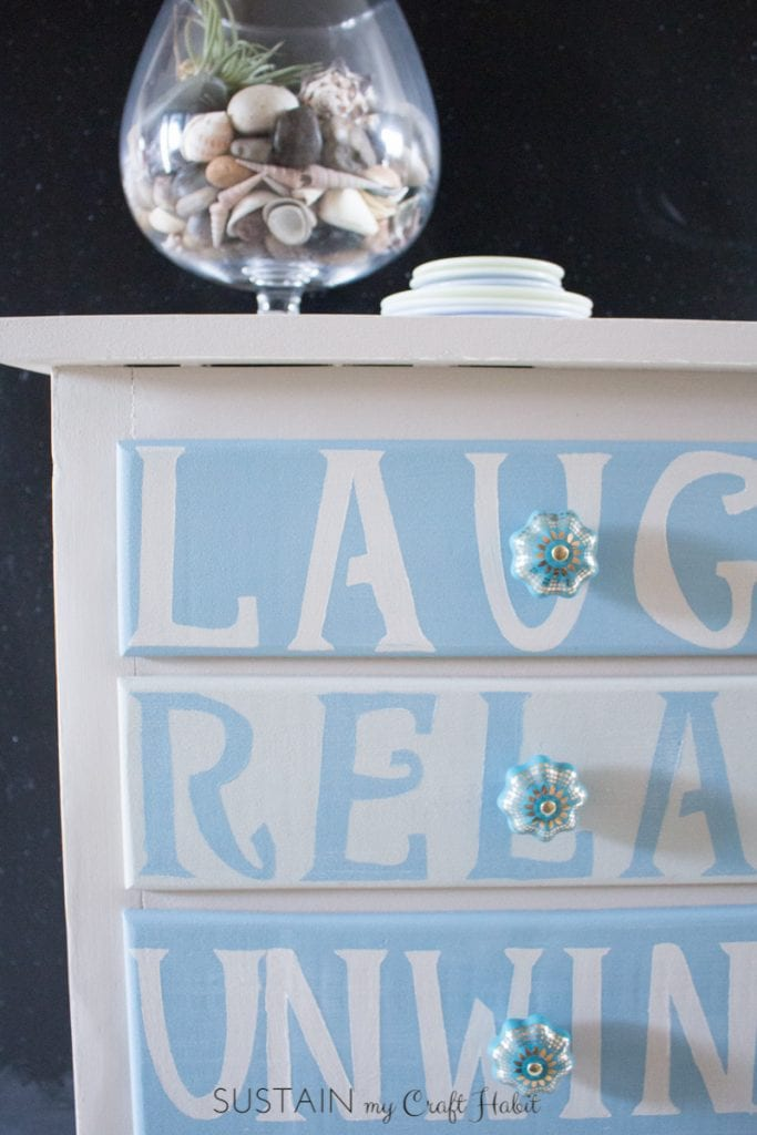 An old dresser found at a farmhouse yardsale gets a new life as a functional coastal-inspired home decor piece with beautiful paint and vintage hardware.