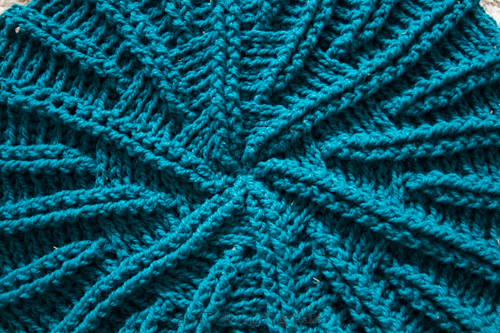 Close up image of the radial pattern on the round crochet throw pillow pattern