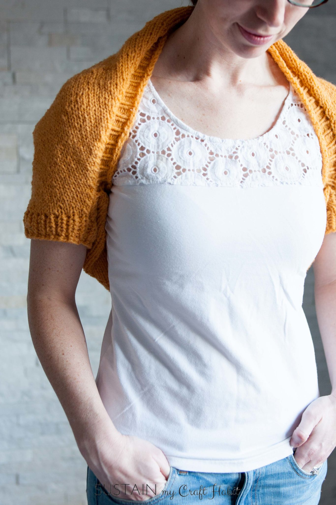 Beautiful and bright simple Sunrise Shrug free knitting pattern from SustainMyCraftHabit. This lightweight wool knit shrug is perfect for cool spring days and autumn nights.