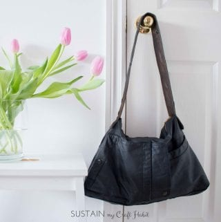 A dated leather jacket gets a new purpose in life as a useful, edgy and beautiful new DIY bag. This one-of-a-kind upcycled handbag is a great weekend sewing project. The detailed step-by-step tutorial is included.