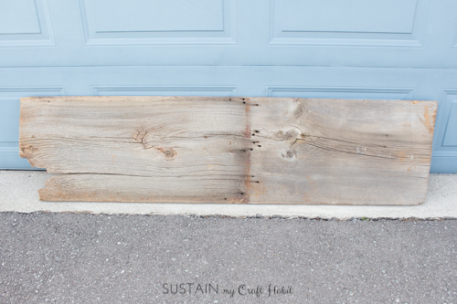 Original piece of barn board purchased at an antique shop to make a DIY console table with