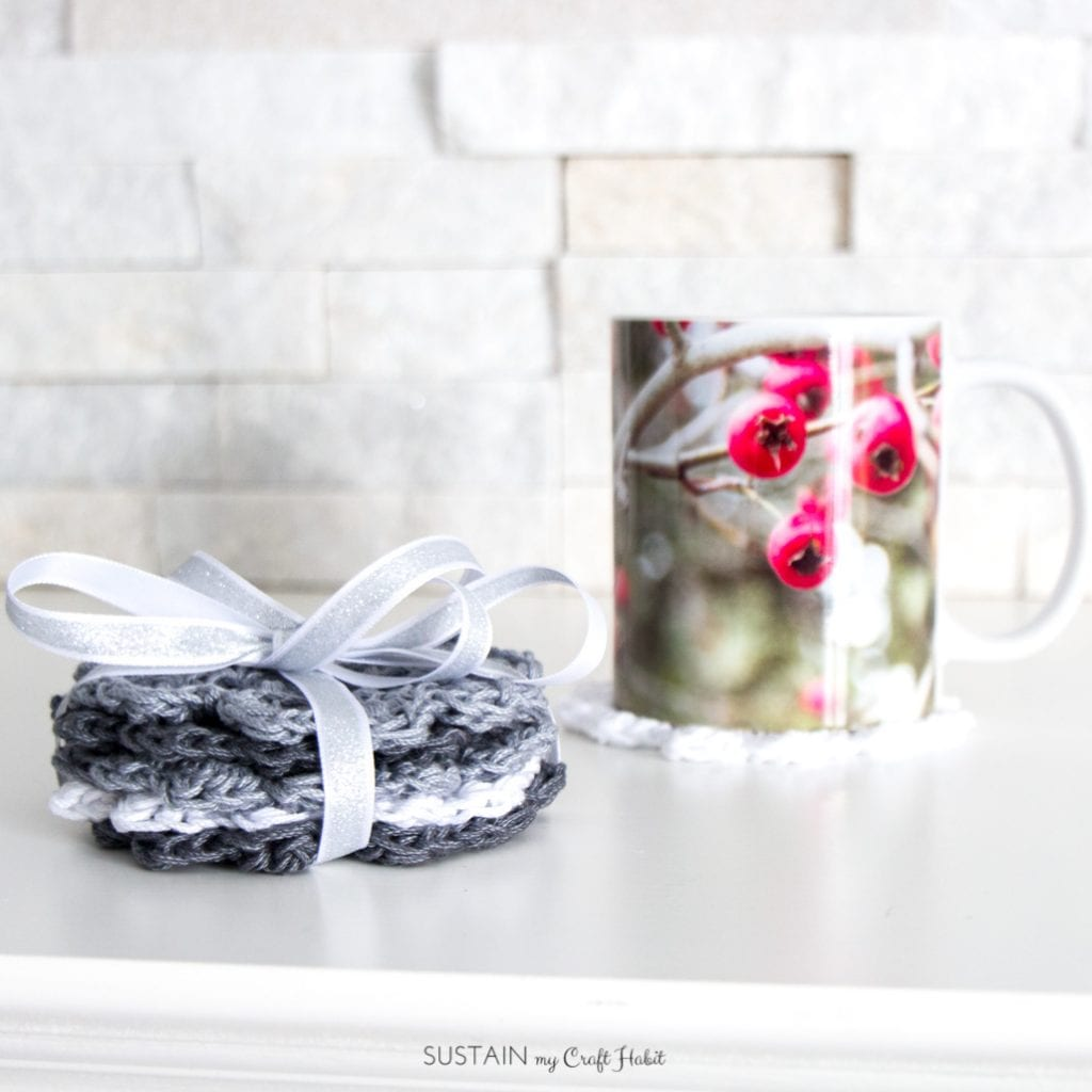 Learn how to crochet a coaster with this easy free crochet coaster pattern. Step-by-step photo tutorial makes them great coaster patterns for beginners. Thoughtful handmade gift ideas for coffee lovers. #crochet #coasters #handmadegiftidea #lionbrandyarn
