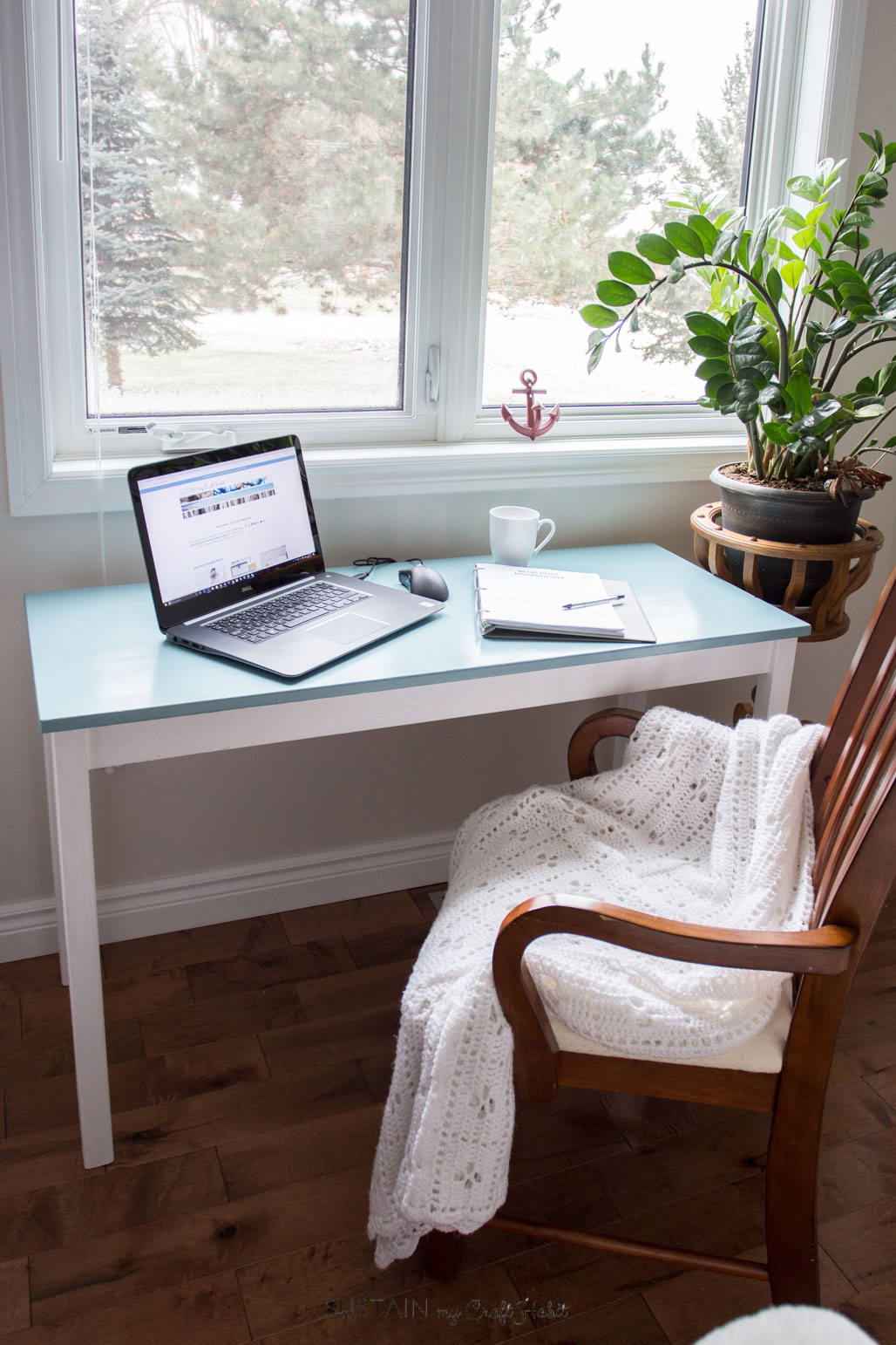 A little paint gives new life to an old wooden table and inspires a fresh and cozy office nook. Full tutorial on painting yellowing furniture.