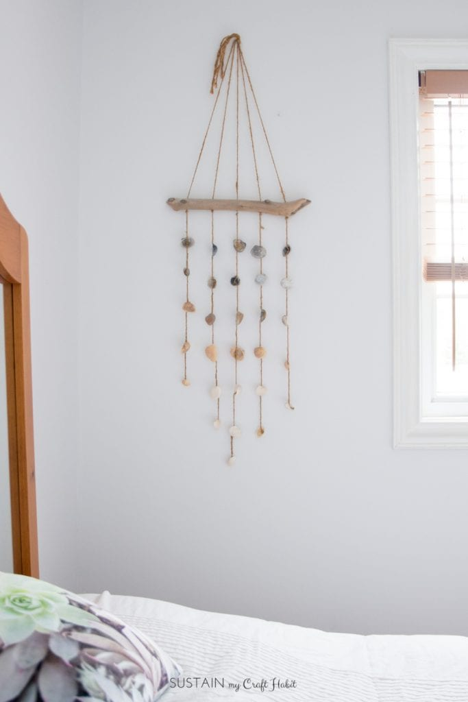 This seashell wind chime is so easy to make and can be used indoors as a coastal cottage décor idea for your bedroom wall.