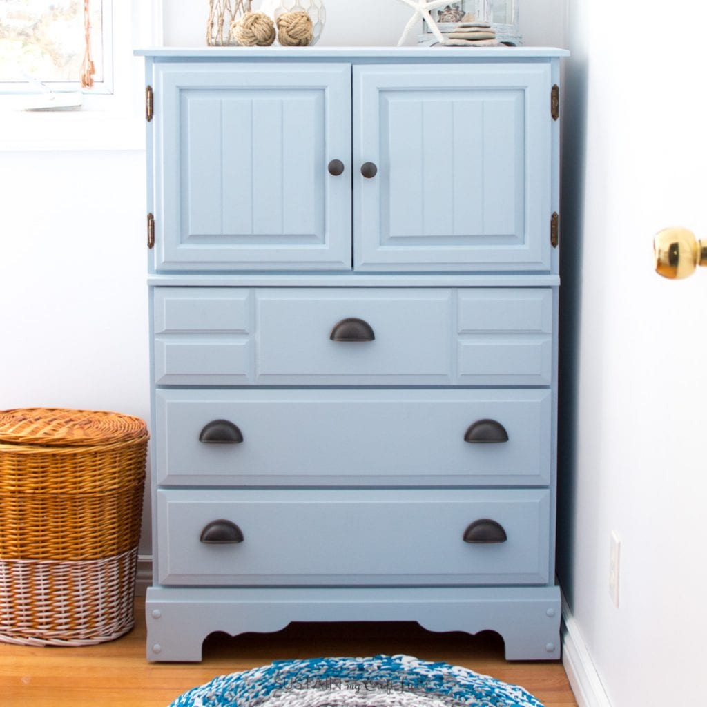 This tutorial on how to paint a dresser without sanding will make you want to upcycle all your furniture. The DIY chalk-style paint tall dresser makeover would be perfect for a coastal style cottage, boy's room or nursery.