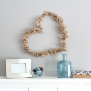 Simple heart-shaped rustic wreath with burlap.
