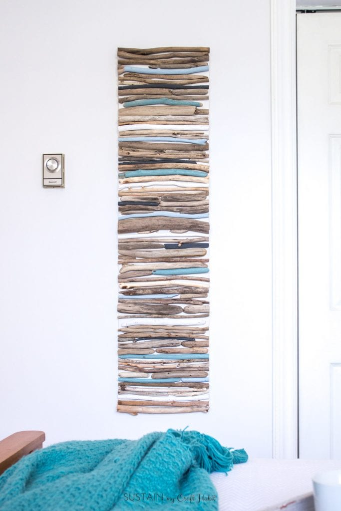 DIY coastal decor idea! Learn how to make this driftwood wall art for your home or cottage.