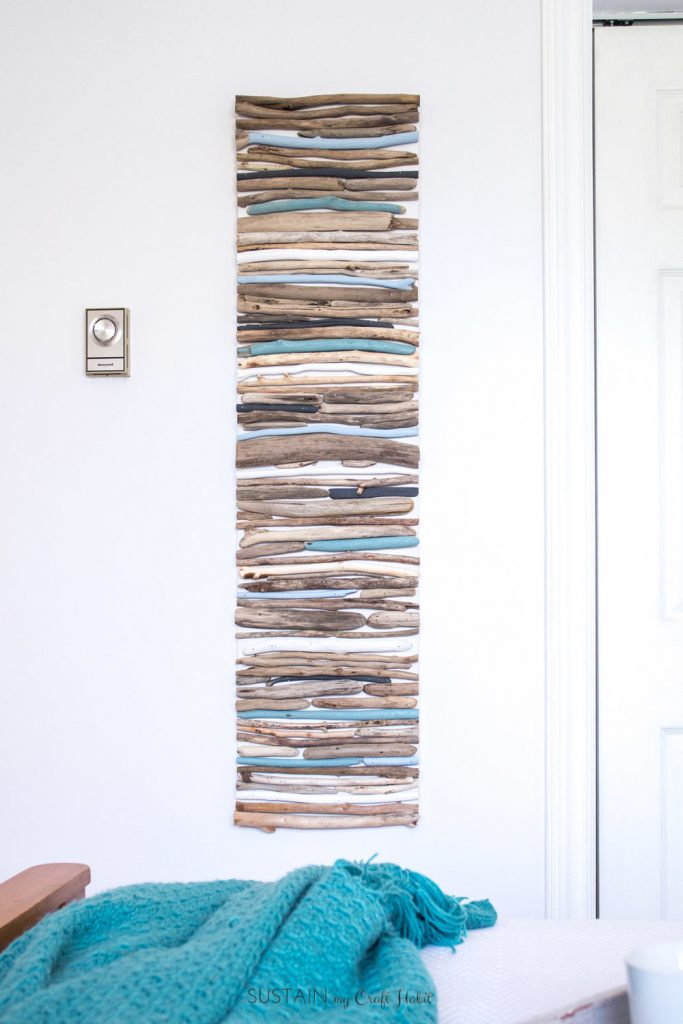 DIY wall art made with painted pieces of driftwood
