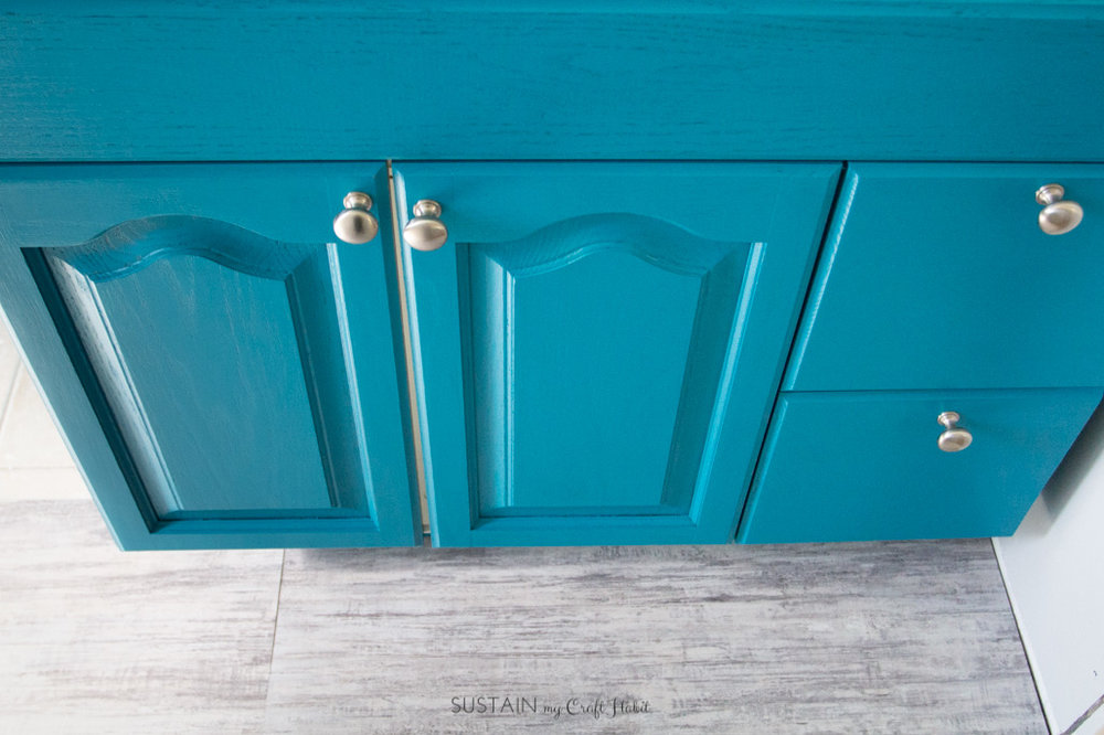 Give old vanity cabinets a facelift with some paint to save costs in a small bathroom remodel