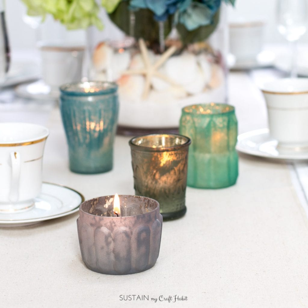Gorgeous mercury glass votive holders as a part of this beach themed tablescape idea