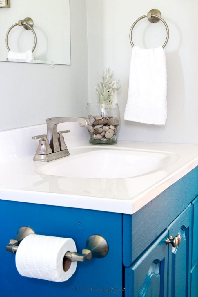 DIY ideas for a beach themed bathroom. Upcycled vanity, new counters and a faucets in this small bathroom remodel tour.