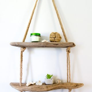 DIY Hanging Rope Shelf with Driftwood. Rustic coastal decor idea in this beach themed bathroom remodel tour.
