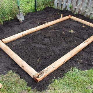 How to build a simple raised garden bed. Easy DIY project for making a vegetable or flower box in your backyard.