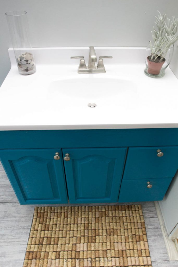 Beach themed bathroom vanity upcycled with teal paint and new countertop.