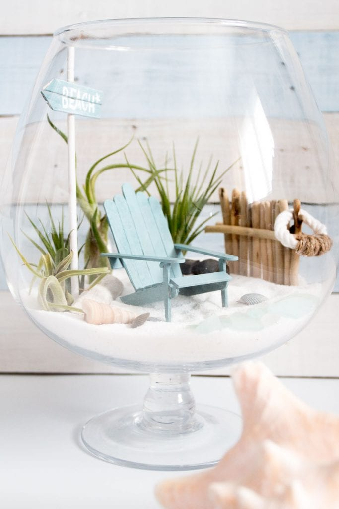 Fairy garden terrarium in a beach theme