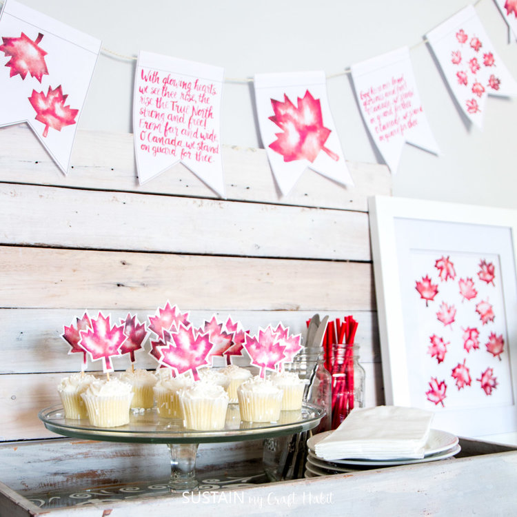 Celebrate Canada Day with this red and white. Grab free printable banners, cupcake toppers and art.