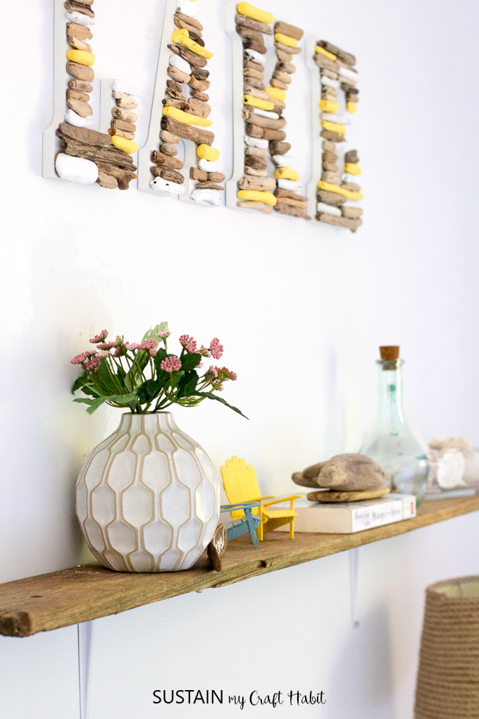 Make a simple, rustic DIY shelf with driftwood! Perfect home decor accessory for the lakehouse or cottage. DIY live edge shelf.