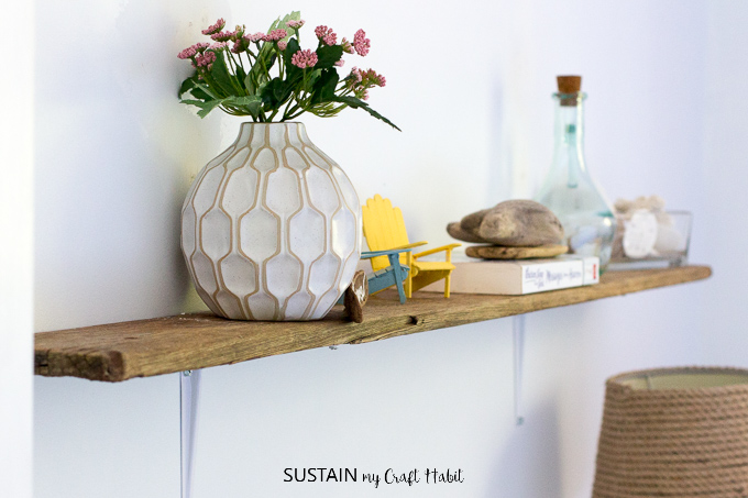 DIY shelves made with driftwood and inexpensive hardware store wall brackets.