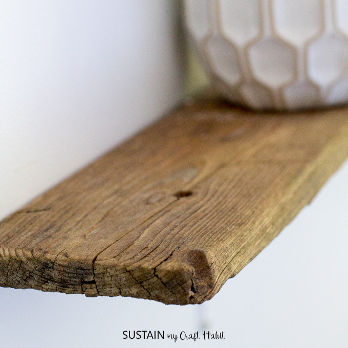 DIY driftwood shelves with a rustic live-edge. Simple and natural beach house or cottage decor idea.