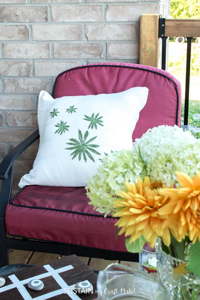 DIY throw pillow plus 11 other patio decorating ideas for a relaxing patio retreat.
