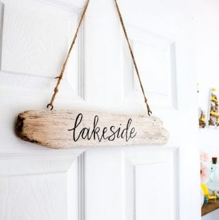 Make these DIY driftwood signs for your home or cottage. With a brush-lettering trick that'll make your lettering look like a pro. Full tutorial included.