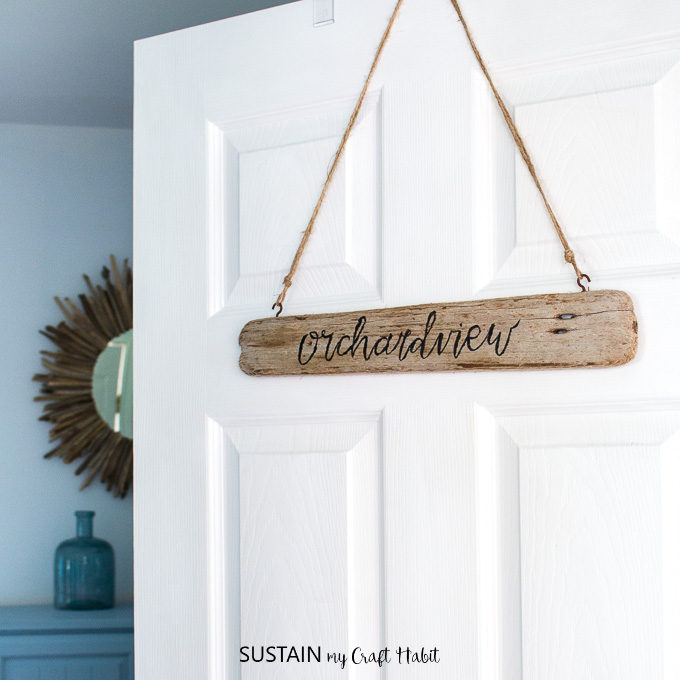 Add a little coastal personality to your cottage or home with this DIY driftwood sign. A little brush lettering cheat is included!