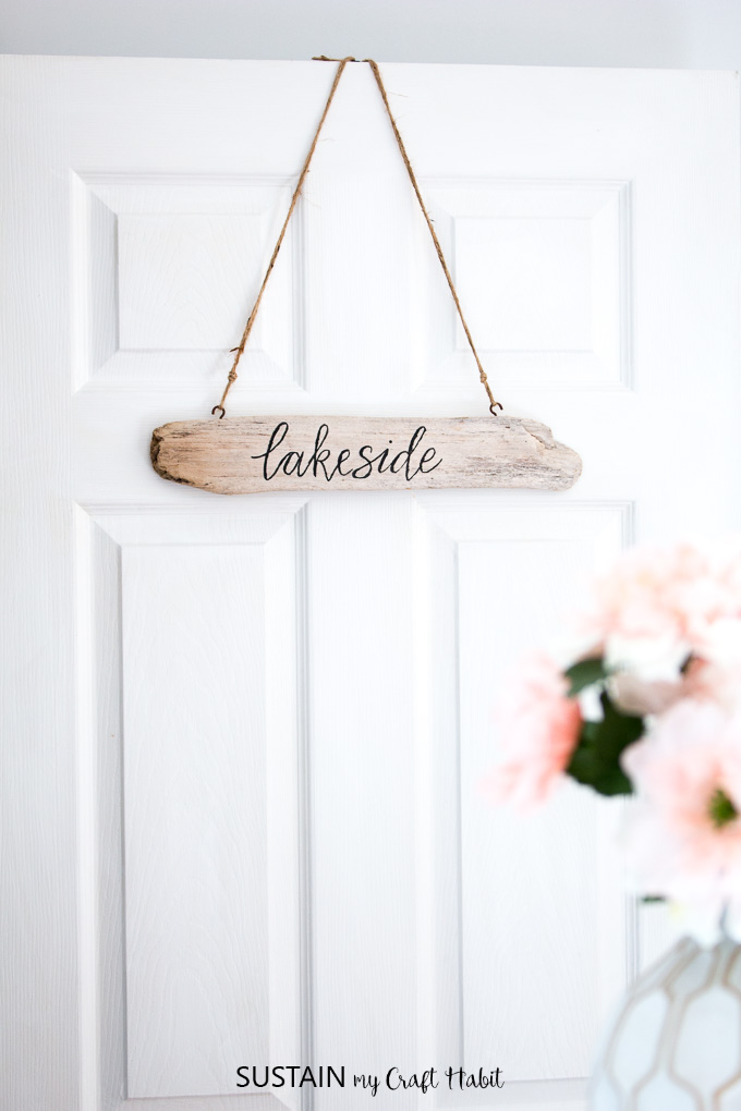 This hand-lettered DIY driftwood sign is a great way to add a little coastal personality to your cottage or home. A little brush lettering cheat is included!