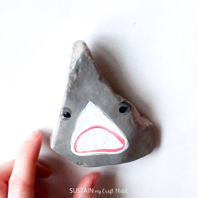 how to paint a shark head on a rock