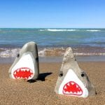 Shark painted rocks! How fun are these guys. Video tutorial for how to paint rocks into toothy sharks.