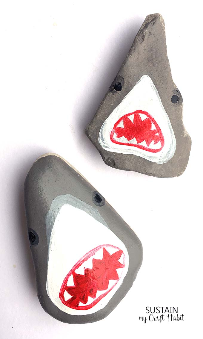 So great! Learn how to paint these hilarious shark heads on rocks! Perfect rock painting craft for the summer!