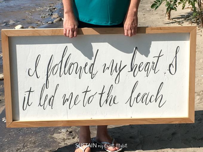Make your own farmhouse sign with scrap wood pieces. Full tutorial for this beach-theme bedroom decor idea included!