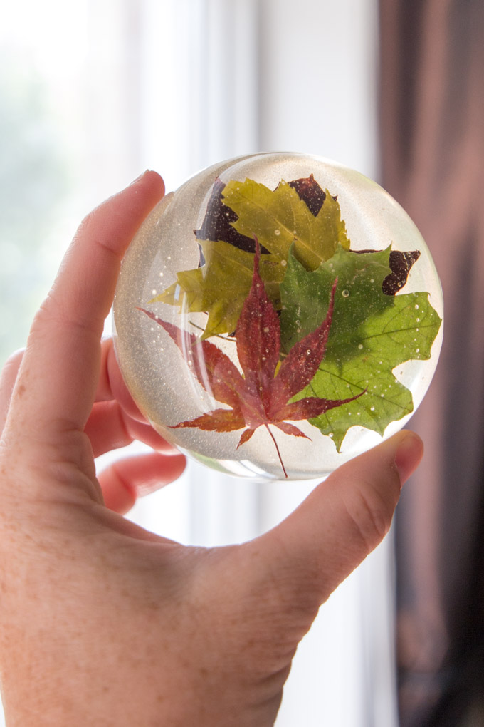 Beautiful nature-inspired resin paperweight made with real maple leaves. Full DIY tutorial included for this fall craft and office decor idea.