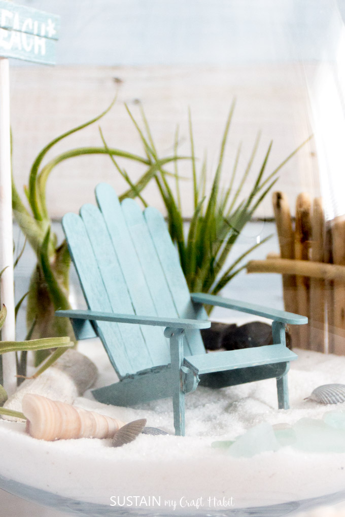 DIY mini Adirondack chairs that are perfect for a beach-themed fairy garden. Video tutorial included!