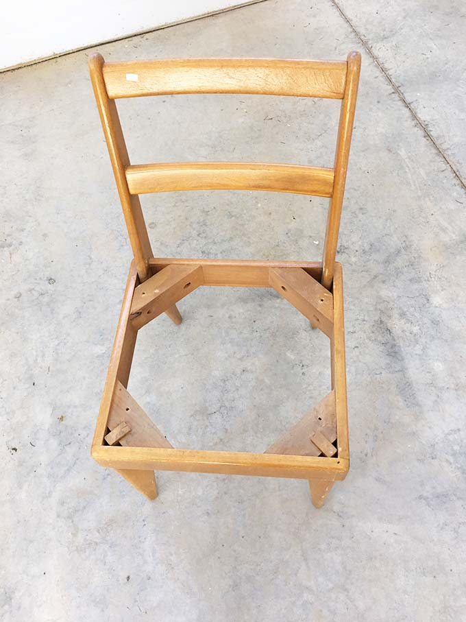 Wooden chair frame with seat cushion removed