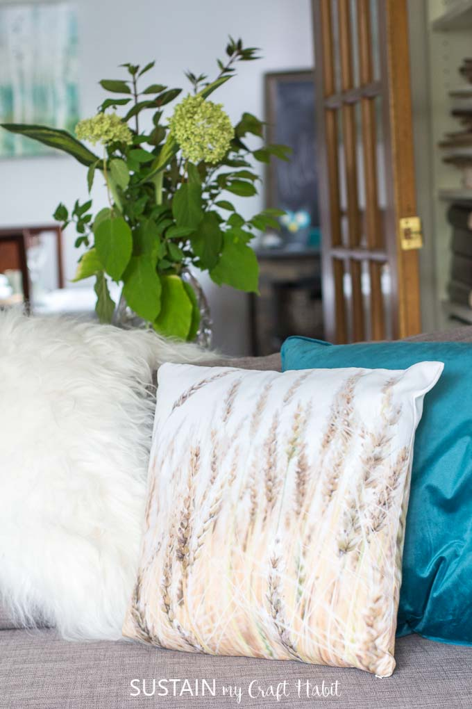 Wheat throw pillow and jewel tones in a rustic chic fall home tour. Inspiring fall home decor ideas.