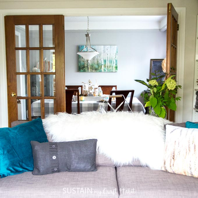 Gorgeous rustic chic living room decorated for fall featuring natural elements and touches of teal.