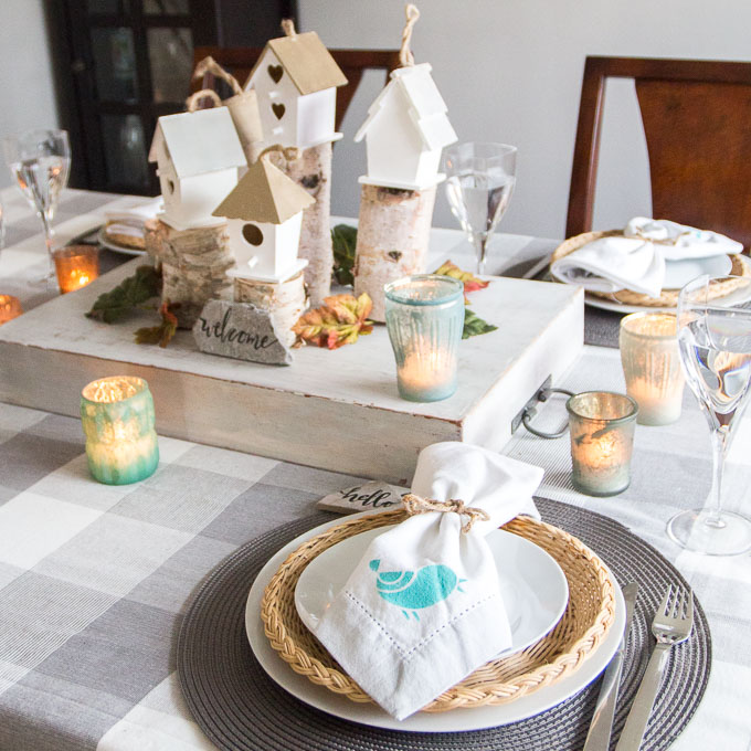 A rustic, woodland-inspired fall tablescape plus over a dozen more Thanksgiving tablescapes.